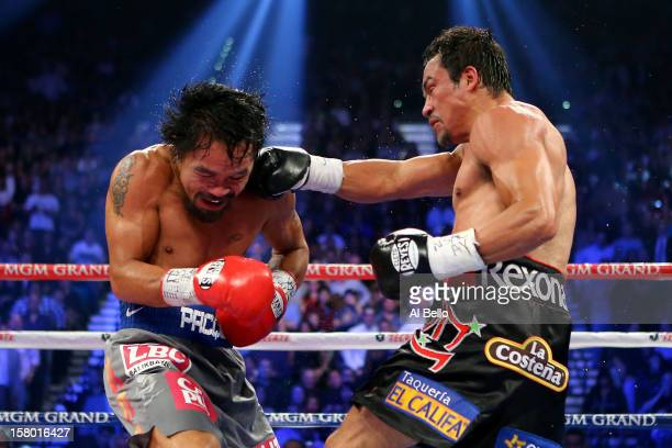 Juan Manuel Marquez lands a right to the face of Manny Pacquiao during their welterweight bout at the MGM Grand Garden Arena on December 8 2012 in...