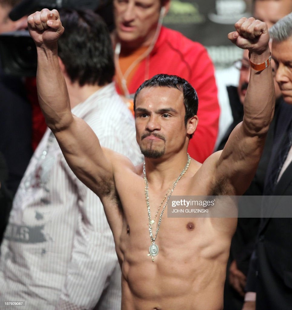 Juan Manuel Marquez of Mexico poses during his weigh-in with Manny Pacquiao of the Philippines (out of frame) December 7, 2012 in Las Vegas, Nevada. Filipino southpaw Pacquiao needs a statement victory over Marquez in the fourth installment of their epic rivalry December 8, 2012 to prove once and for all who is the better fighter. AFP PHOTO / John GURZINSKI