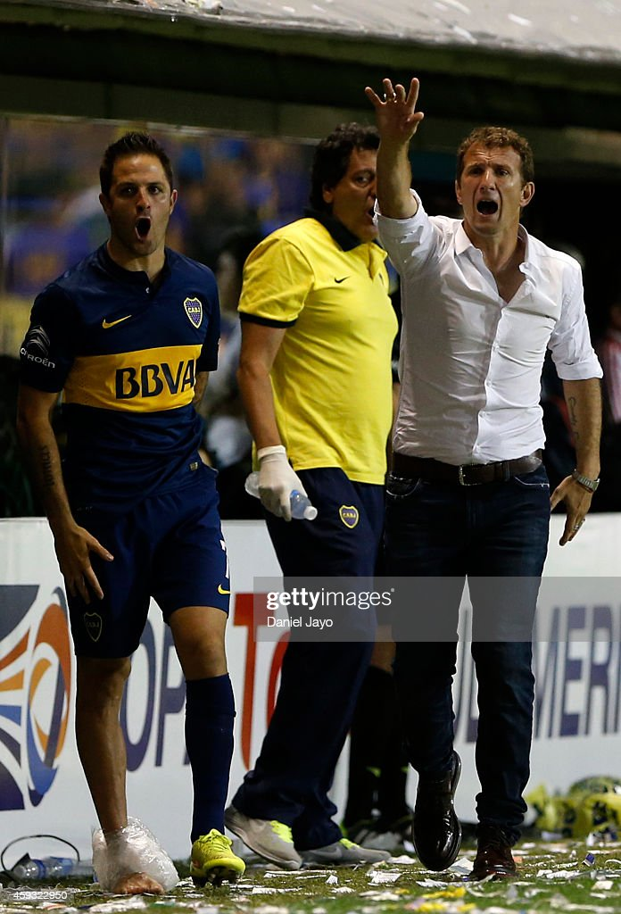 Juan Manuel Martinez, of Boca Juniors, (L) and Rodolfo Arrabarruena, coach of Boca Juniors, react during a first leg semifinal match between Boca Juniors and River Plate as part of Copa Total Sudamericana 2014 at Alberto J Armando Stadium on November 20, 2014 in Buenos Aires, Argentina.