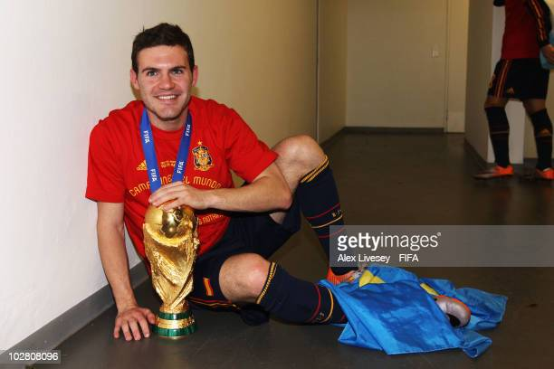 Juan Manuel Mata of Spain celebrates in the Spanish dressing room after they won the 2010 FIFA World Cup at Soccer City Stadium on July 11 2010 in...