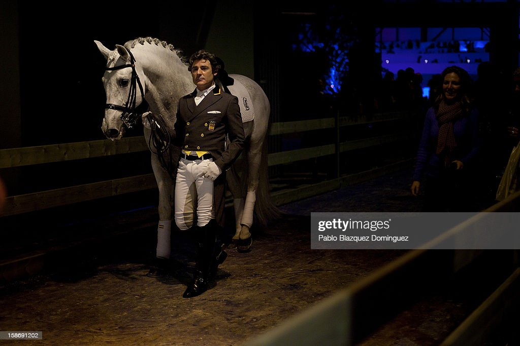 Juan Manuel Munoz Diaz walks with horse Fuego de Cardenas after performing during Madrid Horse Week Fair at Ifema on December 23, 2012 in Madrid, Spain.