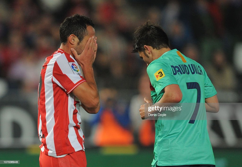 Juan Manuel Ortiz of UD Almeria reacts beside <a gi-track='captionPersonalityLinkClicked' href=/galleries/search?phrase=David+Villa&family=editorial&specificpeople=467566 ng-click='$event.stopPropagation()'>David Villa</a> of Barcelona after Barcelona scored their fifth goal during the La Liga match between UD Almeria and Barcelona at Estadio del Mediterraneo on November 20, 2010 in Almeria, Spain.