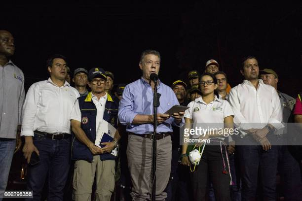 Juan Manuel Santos Colombia's president center speaks during a press conference in the aftermath of flooding and landslides in Villagarzon Putumayo...