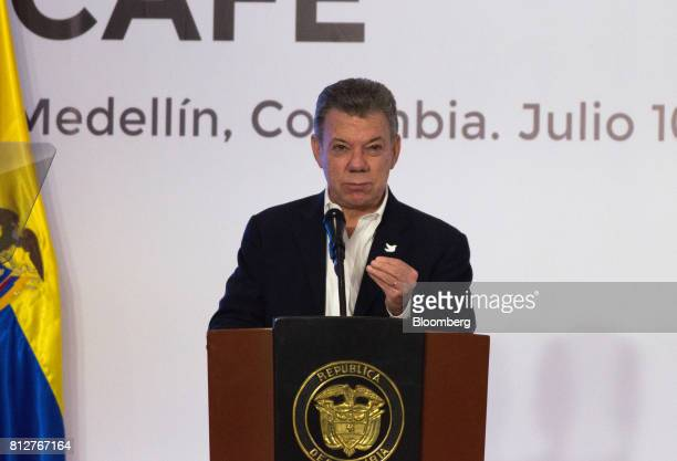 Juan Manuel Santos Colombia's president pauses while speaking during the World Coffee Producers Forum in Medellin Colombia on Tuesday July 11...