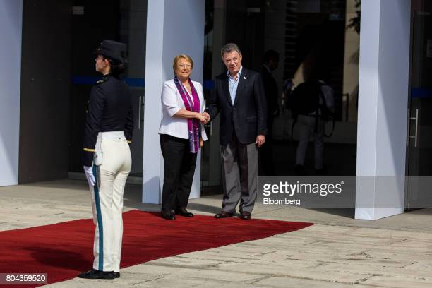 Juan Manuel Santos Colombia's president right shakes hands with Michelle Bachelet Chile's president while arriving to the Pacific Alliance Summit in...