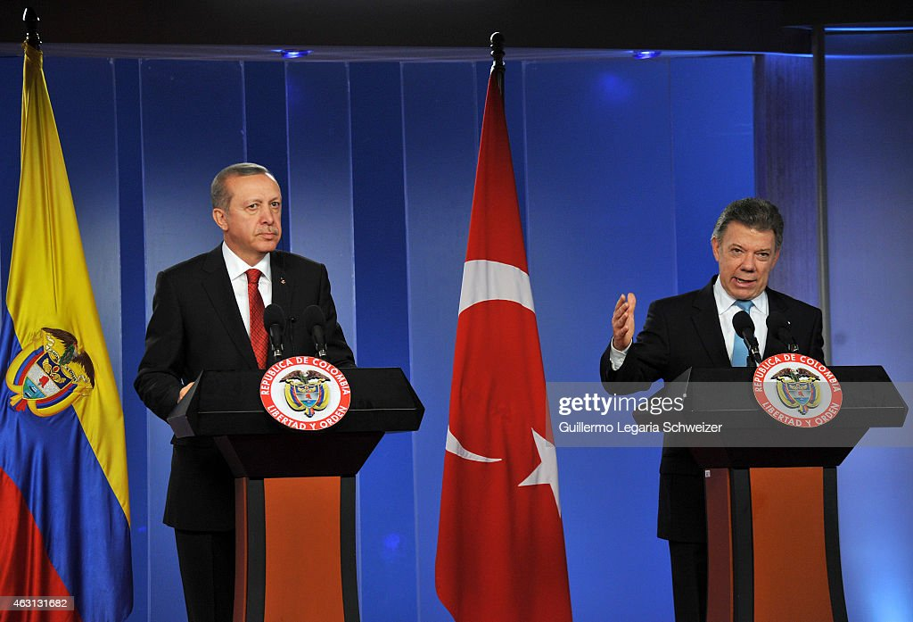 Juan Manuel Santos president of Colombia (R) speaks during a joint press conference with Turkish president Recep Tayyip Erdoga (L) after a meeting at Narino Presidential Palace on February 10, 2015 in Bogota, Colombia. Turkish president is on a two day official visit to Colombia.