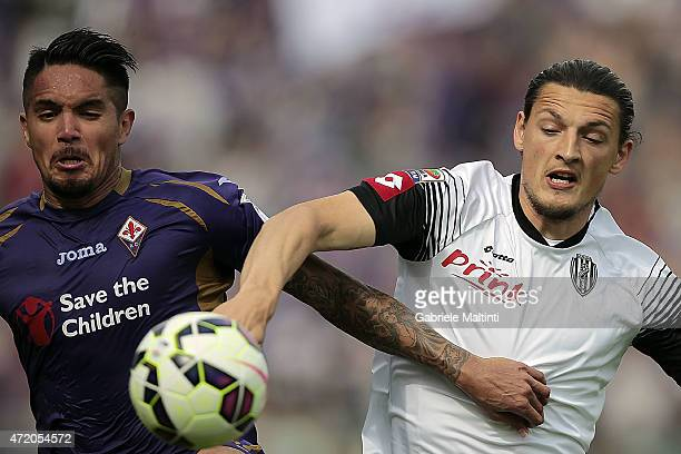 Juan Manuel Vargas of ACF Fiorentina battles for the ball with Milan Djuric of AC Cesena during the Serie A match between ACF Fiorentina and AC...