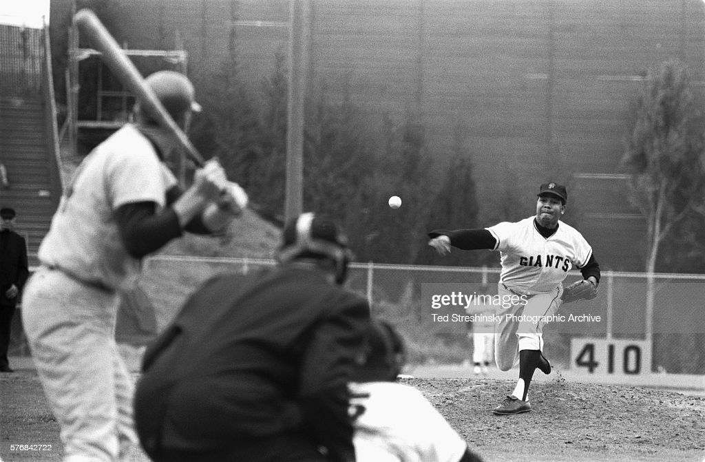 Juan Marichal the pitcher for the San Francisco Giants throws a pitch to a batter during a game