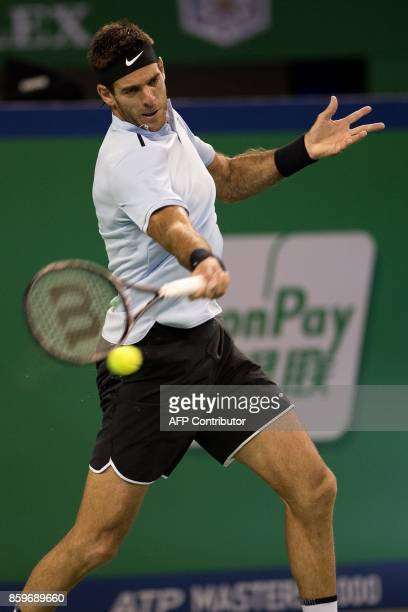 Juan Martin Del Porto of Argentina hits a return during the men's singles against Andrey Rublev of Russia at the Shanghai Masters tennis tournament...