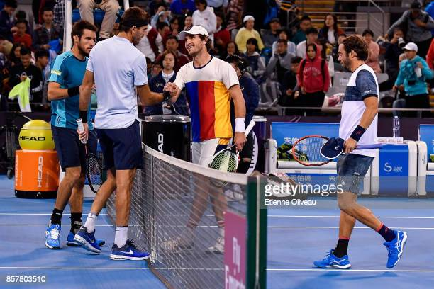Juan Martin del Potro and Leonardo Mayer of Argentina congratulate Paolo Lorenzi of Italy and Mischa Zverev of Germany for their victory during their...