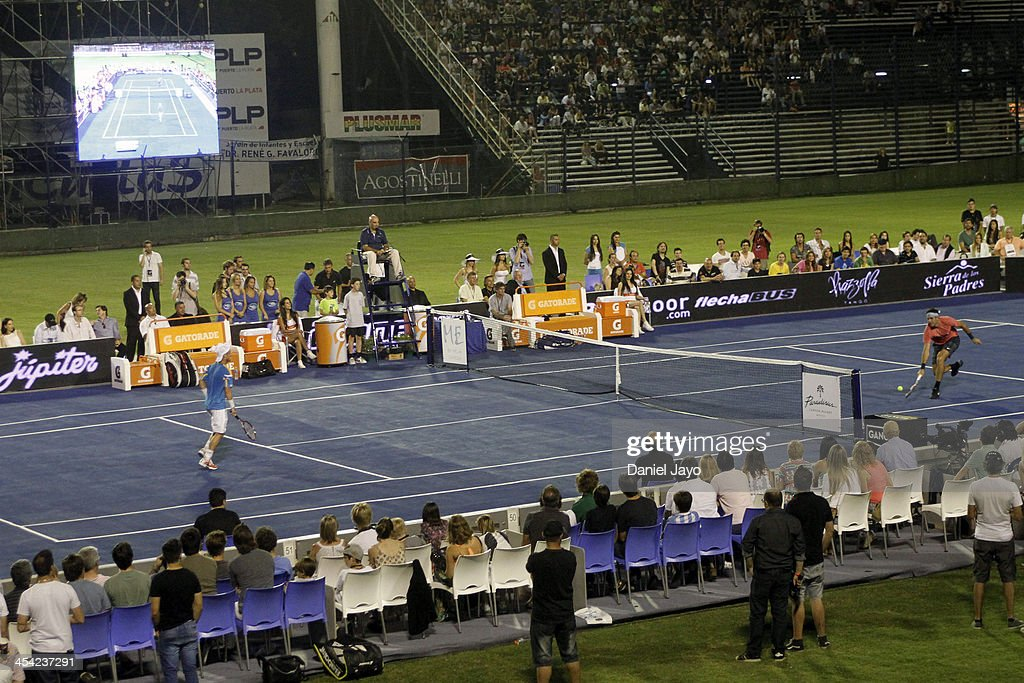 <a gi-track='captionPersonalityLinkClicked' href=/galleries/search?phrase=Juan+Martin+Del+Potro&family=editorial&specificpeople=606583 ng-click='$event.stopPropagation()'>Juan Martin Del Potro</a> and <a gi-track='captionPersonalityLinkClicked' href=/galleries/search?phrase=Lleyton+Hewitt&family=editorial&specificpeople=167178 ng-click='$event.stopPropagation()'>Lleyton Hewitt</a> during an exhibition match at Juan Carmelo Zerillo Stadium on December 07, 2013 in La Plata, Argentina.