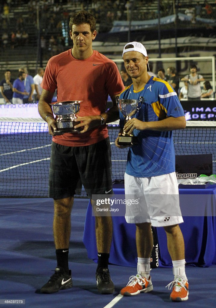 Juan Martin Del Potro (L) and Lleyton Hewitt pose for a photo with their trophies during an exhibition match at Juan Carmelo Zerillo Stadium on December 07, 2013 in La Plata, Argentina.