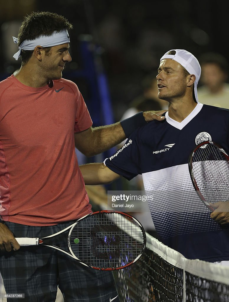 <a gi-track='captionPersonalityLinkClicked' href=/galleries/search?phrase=Juan+Martin+Del+Potro&family=editorial&specificpeople=606583 ng-click='$event.stopPropagation()'>Juan Martin Del Potro</a> (L) and <a gi-track='captionPersonalityLinkClicked' href=/galleries/search?phrase=Lleyton+Hewitt&family=editorial&specificpeople=167178 ng-click='$event.stopPropagation()'>Lleyton Hewitt</a> talk during an exhibition match at Juan Carmelo Zerillo Stadium on December 07, 2013 in La Plata, Argentina.