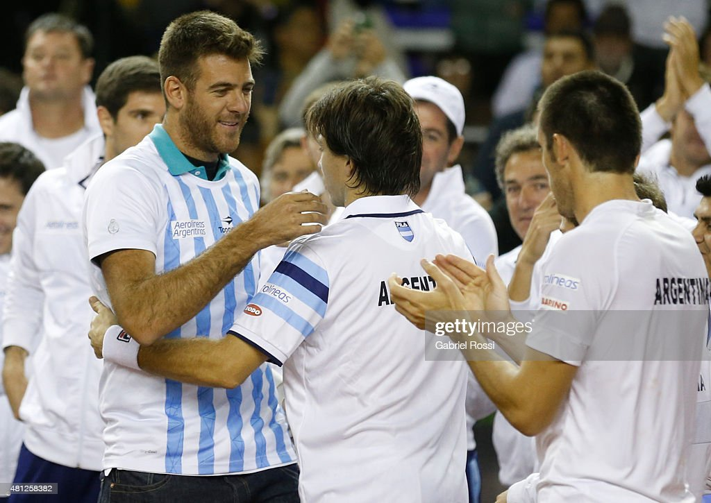<a gi-track='captionPersonalityLinkClicked' href=/galleries/search?phrase=Juan+Martin+Del+Potro&family=editorial&specificpeople=606583 ng-click='$event.stopPropagation()'>Juan Martin Del Potro</a> greets <a gi-track='captionPersonalityLinkClicked' href=/galleries/search?phrase=Carlos+Berlocq&family=editorial&specificpeople=553854 ng-click='$event.stopPropagation()'>Carlos Berlocq</a> of Argentina after winning a quarter final doubles match between <a gi-track='captionPersonalityLinkClicked' href=/galleries/search?phrase=Carlos+Berlocq&family=editorial&specificpeople=553854 ng-click='$event.stopPropagation()'>Carlos Berlocq</a> / Leonardo Mayer (ARG) and Viktor Troicki / Nenan Zimonjic (SRB) as part of Davis Cup 2015 at Tecnopolis on July 18, 2015 in Villa Martelli, Argentina.