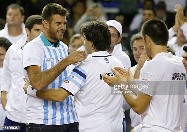 Juan Martin Del Potro greets Carlos Berlocq of Argentina after winning a quarter final doubles match between Carlos Berlocq / Leonardo Mayer and...