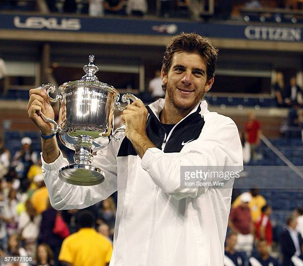 Juan Martin del Potro holds up the Mens Championship Trophy after his 2009 US Open Mens Championship match against Roger Federer in Arthur Ashe...