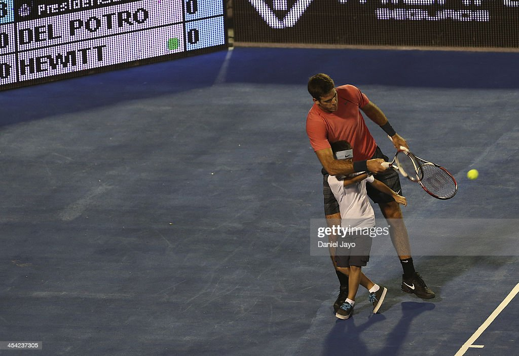 <a gi-track='captionPersonalityLinkClicked' href=/galleries/search?phrase=Juan+Martin+Del+Potro&family=editorial&specificpeople=606583 ng-click='$event.stopPropagation()'>Juan Martin Del Potro</a> jokes with a child during an exhibition match against Lleyton Hewitt at Juan Carmelo Zerillo Stadium on December 07, 2013 in La Plata, Argentina.