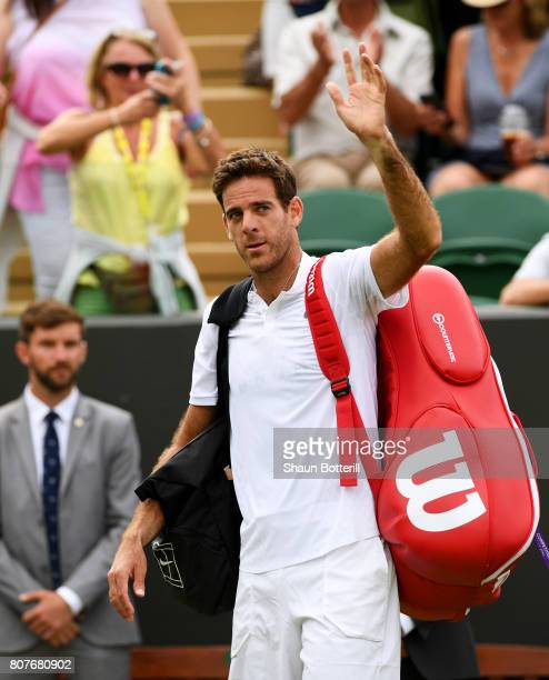 Juan Martin Del Potro of Argentina acknowledges the crowd as he celebrates victory after his Gentlemen's Singles first round match against Thanasi...
