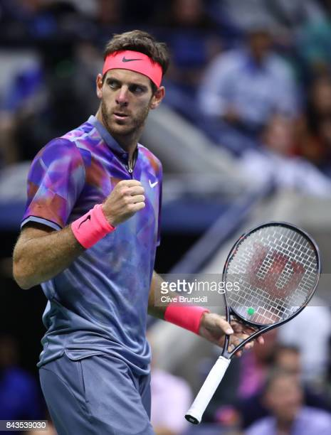 Juan Martin del Potro of Argentina celebrates a point against Roger Federer of Switzerland during their Men's Singles Quarterfinal match on Day Ten...