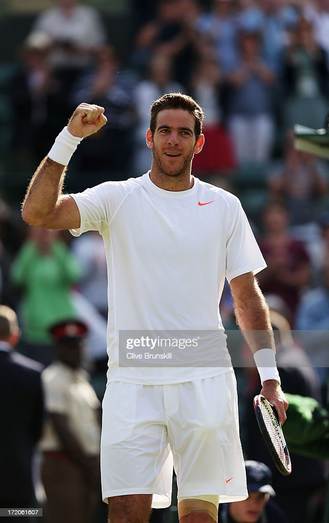 Juan Martin Del Potro of Argentina celebrates match point during the Gentlemen's Singles fourth round match against Andreas Seppi of Italy on day seven of the Wimbledon Lawn Tennis Championships at the All England Lawn Tennis and Croquet Club on July 1, 2013 in London, England.