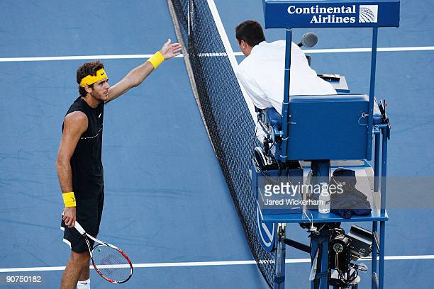Juan Martin Del Potro of Argentina disputes a call to chair judge Jake Garner during the Men�s Singles final against Roger Federer of Switzerland on...