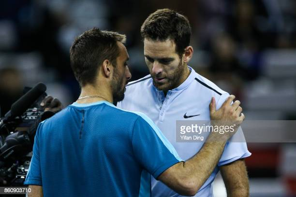 Juan Martin del Potro of Argentina greets his opponent after winning the Men's singles quarter final mach against Viktor Troicki of Serbia on day six...