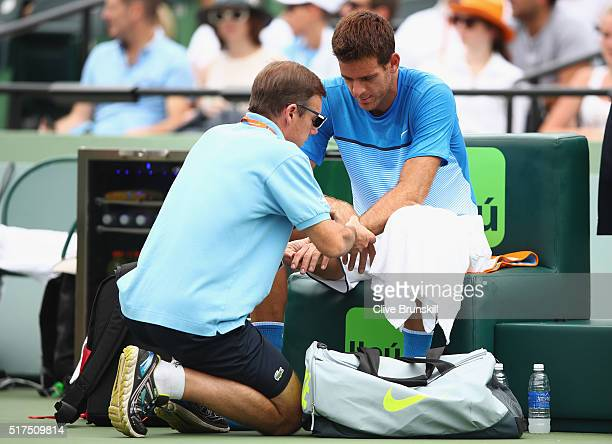 Juan Martin Del Potro of Argentina has his wrist checked by a physio during an injury time out against Horacio Zeballos of Argentina in their second...