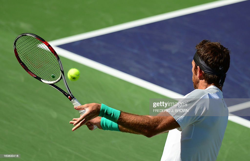 Juan Martin Del Potro of Argentina hits a backhand return against Novak Djokovic of Serbia on March 16, 2013 in Indian Wells, California, during their semifinal match at the BNP Paribas Open. AFP PHOTO/Frederic J. BROWN