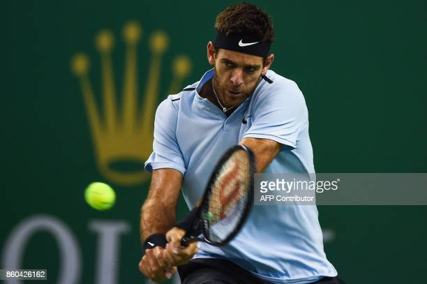Juan Martin del Potro of Argentina hits a return against Alexander Zverev of Germany during their men's singles match at the Shanghai Masters tennis...