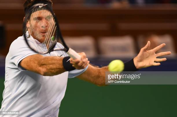 Juan Martin Del Potro of Argentina hits a return against Viktor Troicki of Serbia during their men's singles quarterfinal match at the Shanghai...