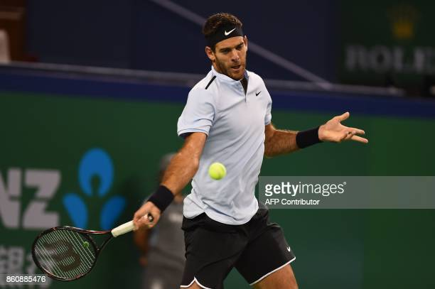 Juan Martin Del Potro of Argentina hits a return against Viktor Troicki of Serbia during their men's singles quarterfinal match at the Shanghai...