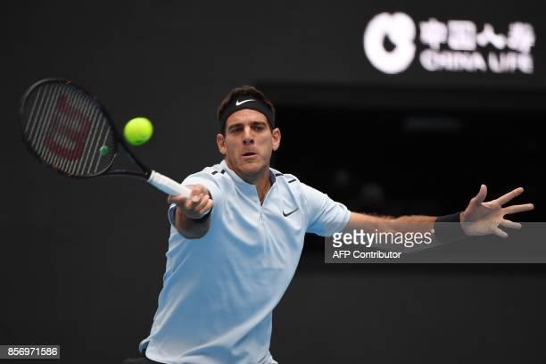 Juan Martin Del Potro of Argentina hits a return during his men's singles match against Pablo Cuevas of Uruguay at the China Open tennis tournament...