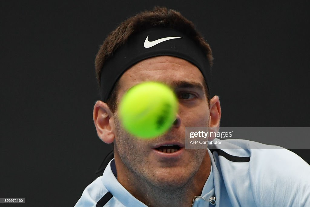 Juan Martin Del Potro of Argentina hits a return during his men's singles match against Pablo Cuevas of Uruguay at the China Open tennis tournament in Beijing on October 3, 2017. /