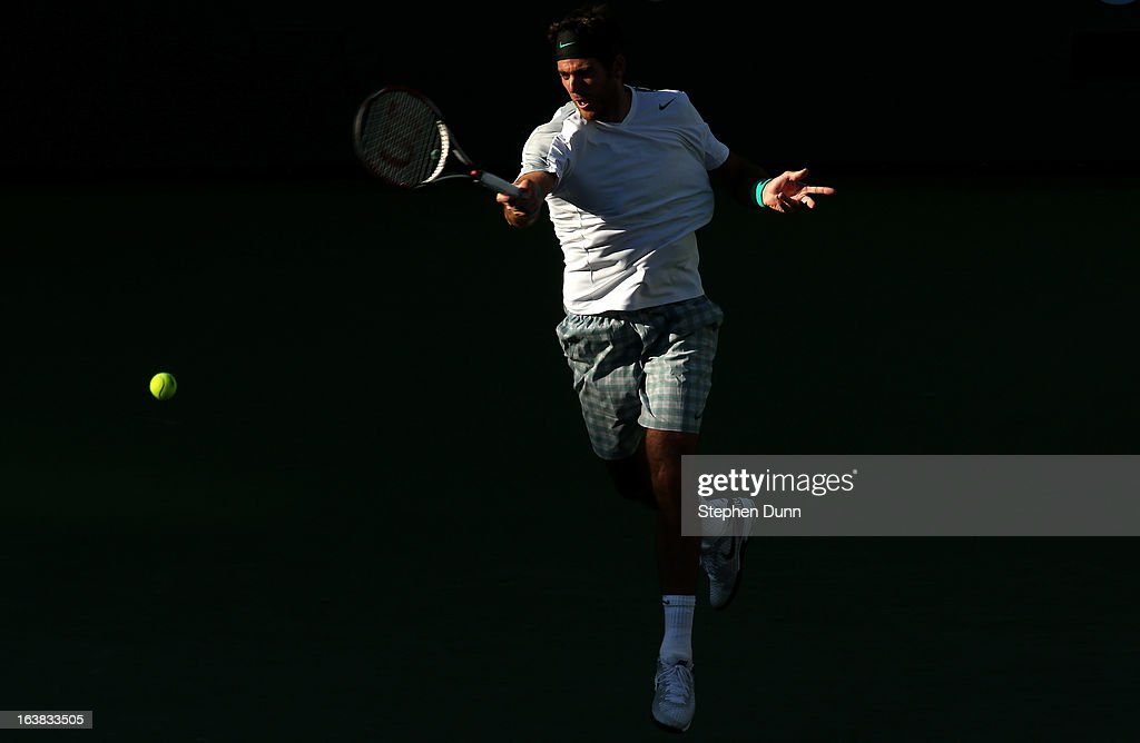 Juan Martin del Potro of Argentina hits a return to Novak Djokovic of Serbia during the men's semifinal match of day 11 of the BNP Paribas Open at Indian Wells Tennis Garden on March 16, 2013 in Indian Wells, California.