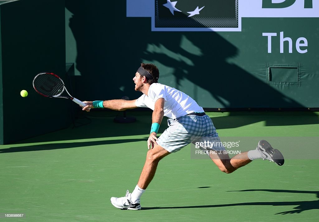 Juan Martin Del Potro of Argentina hits a return to Rafael Nadal of Spain on March 17, 2013 in Indian Wells, California, during the men's BNP Paribas Open final. AFP PHOTO/Frederic J. BROWN