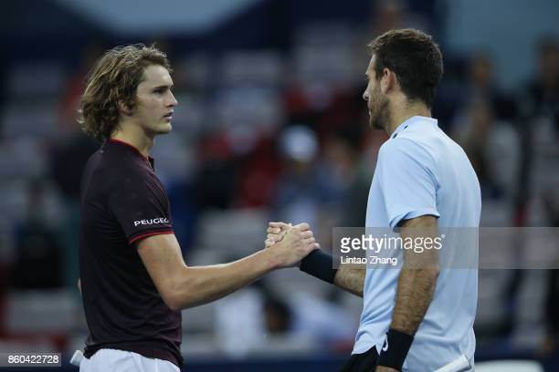 Juan Martin Del Potro of Argentina is congratulated by Alexander Zverev of Germany after winning the Men's singles mach third round on day five of...