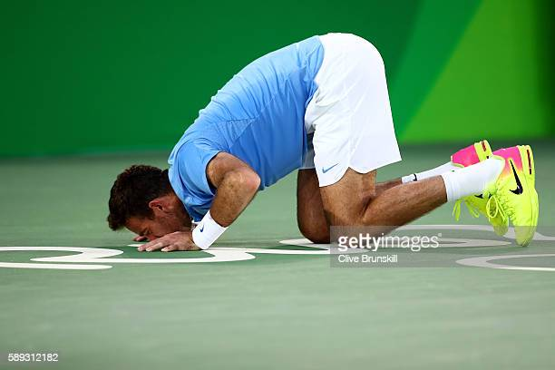 Juan Martin Del Potro of Argentina kisses the court after defeating Rafael Nadal of Spain in the Men's Singles Semifinal Match on Day 8 of the Rio...