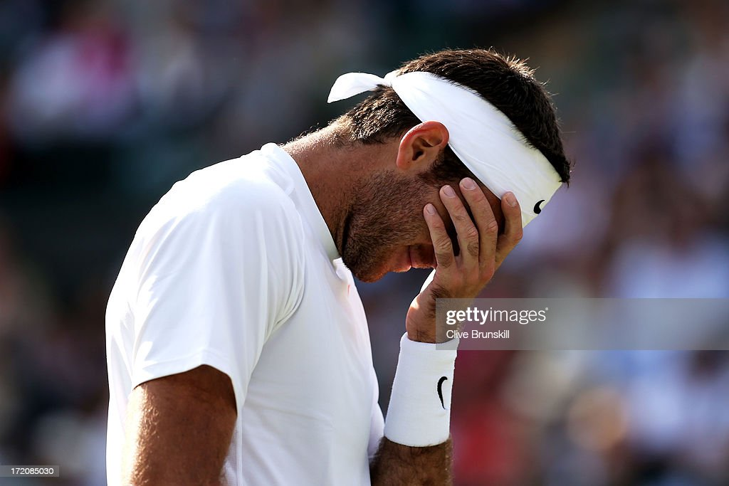 Juan Martin Del Potro of Argentina looks dejected during the Gentlemen's Singles fourth round match against Andreas Seppi of Italy on day seven of the Wimbledon Lawn Tennis Championships at the All England Lawn Tennis and Croquet Club on July 1, 2013 in London, England.