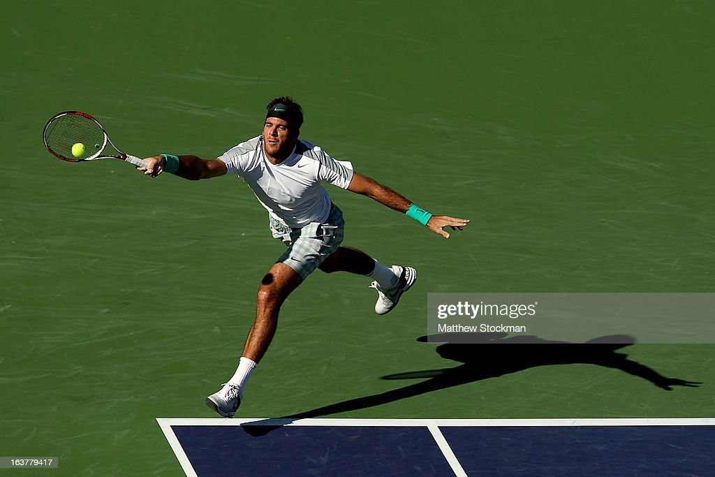 Juan Martin Del Potro of Argentina lunges for a shot while playing Andy Murray of Great Britain during the BNP Paribas Open at the Indian Wells Tennis Garden on March 15, 2013 in Indian Wells, California.
