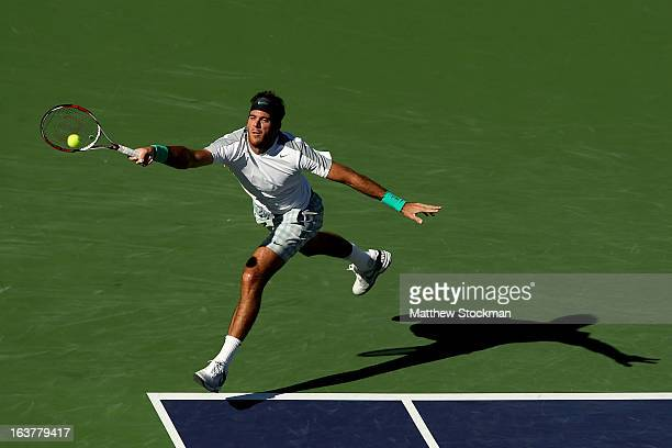 Juan Martin Del Potro of Argentina lunges for a shot while playing Andy Murray of Great Britain during the BNP Paribas Open at the Indian Wells...