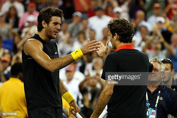 Juan Martin Del Potro of Argentina meets Roger Federer of Switzerland at the net after the Men's Singles final on day fifteen of the 2009 US Open at...