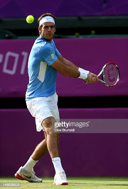 Juan Martin Del Potro of Argentina plays a backhand during the Men's Singles Tennis match against Andreas Seppi of Italy on Day 3 of the London 2012...