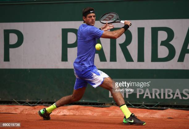 Juan Martin Del Potro of Argentina plays a backhand during the mens singles first round match against Guido Pella on day three of the 2017 French...