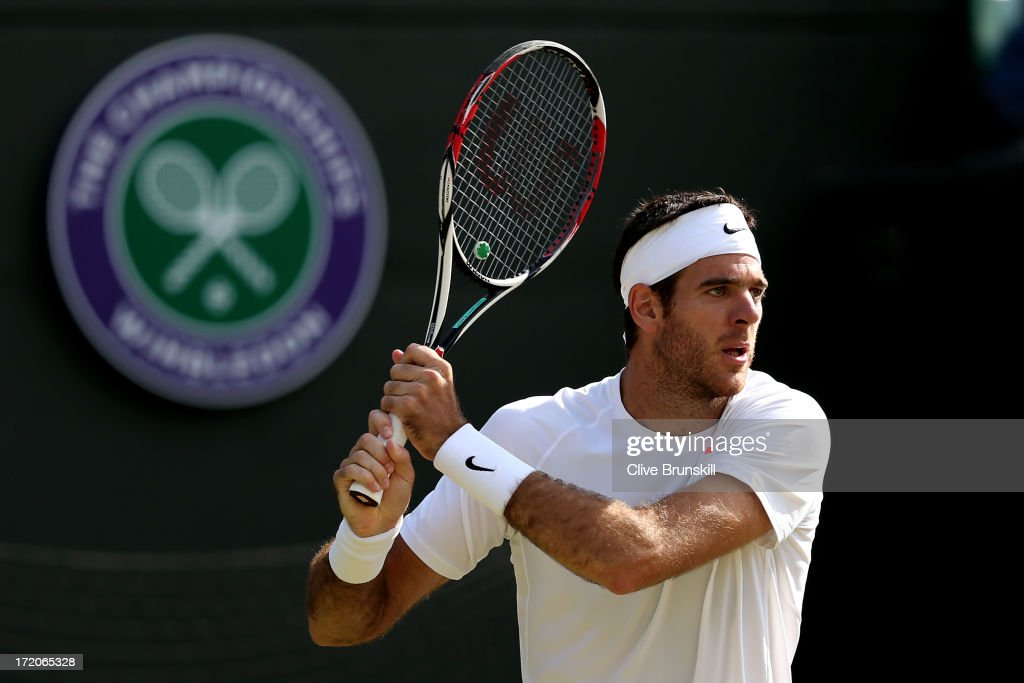 Juan Martin Del Potro of Argentina plays a backhand during the Gentlemen's Singles fourth round match against Andreas Seppi of Italy on day seven of the Wimbledon Lawn Tennis Championships at the All England Lawn Tennis and Croquet Club on July 1, 2013 in London, England.