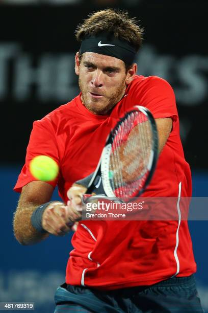 Juan Martin Del Potro of Argentina plays a backhand in the mens singles final against Bernard Tomic of Australia during day seven of the Sydney...