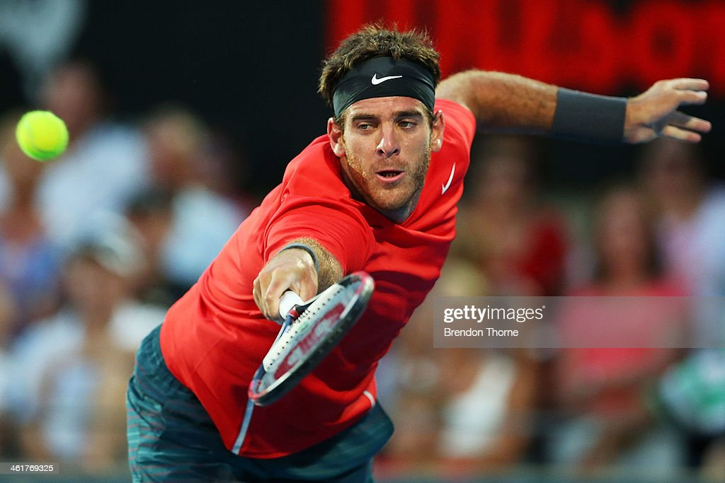 <a gi-track='captionPersonalityLinkClicked' href=/galleries/search?phrase=Juan+Martin+Del+Potro&family=editorial&specificpeople=606583 ng-click='$event.stopPropagation()'>Juan Martin Del Potro</a> of Argentina plays a backhand in the mens singles final against Bernard Tomic of Australia during day seven of the Sydney International at Sydney Olympic Park Tennis Centre on January 11, 2014 in Sydney, Australia.