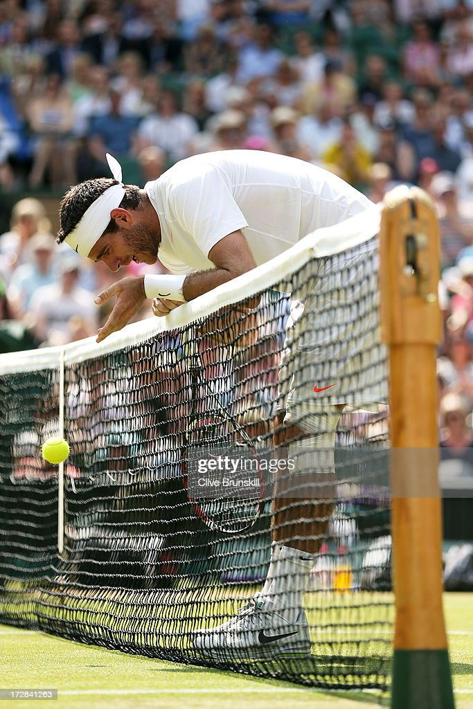 Juan Martin Del Potro of Argentina reacts as he drops a ball over the net after losing a point during the Gentlemen's Singles semi-final match against Novak Djokovic of Serbia on day eleven of the Wimbledon Lawn Tennis Championships at the All England Lawn Tennis and Croquet Club on July 5, 2013 in London, England.