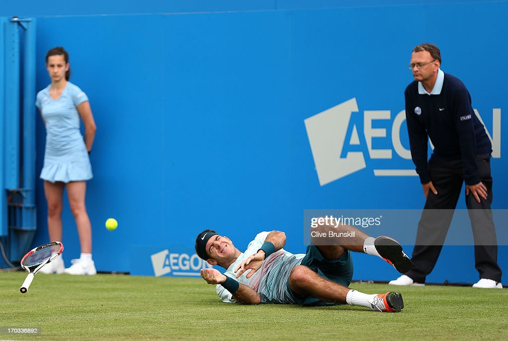 Juan Martin Del Potro of Argentina reacts as he slips during the Men's Singles second round match against Xavier Malisse of Belgium on day two of the AEGON Championships at Queens Club on June 11, 2013 in London, England.