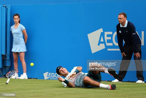 Juan Martin Del Potro of Argentina reacts as he slips during the Men's Singles second round match against Xavier Malisse of Belgium on day two of the...