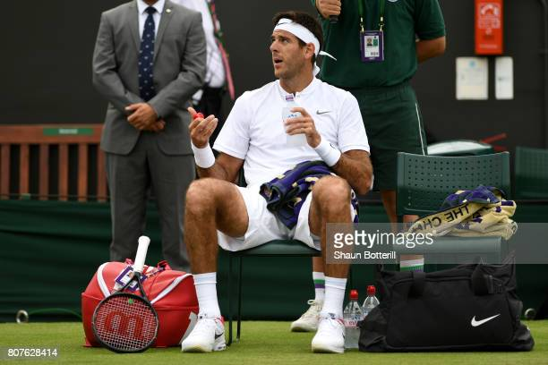 Juan Martin Del Potro of Argentina reacts during a break in play during the Gentlemen's Singles first roud match against Thanasi Kokkinakis of...